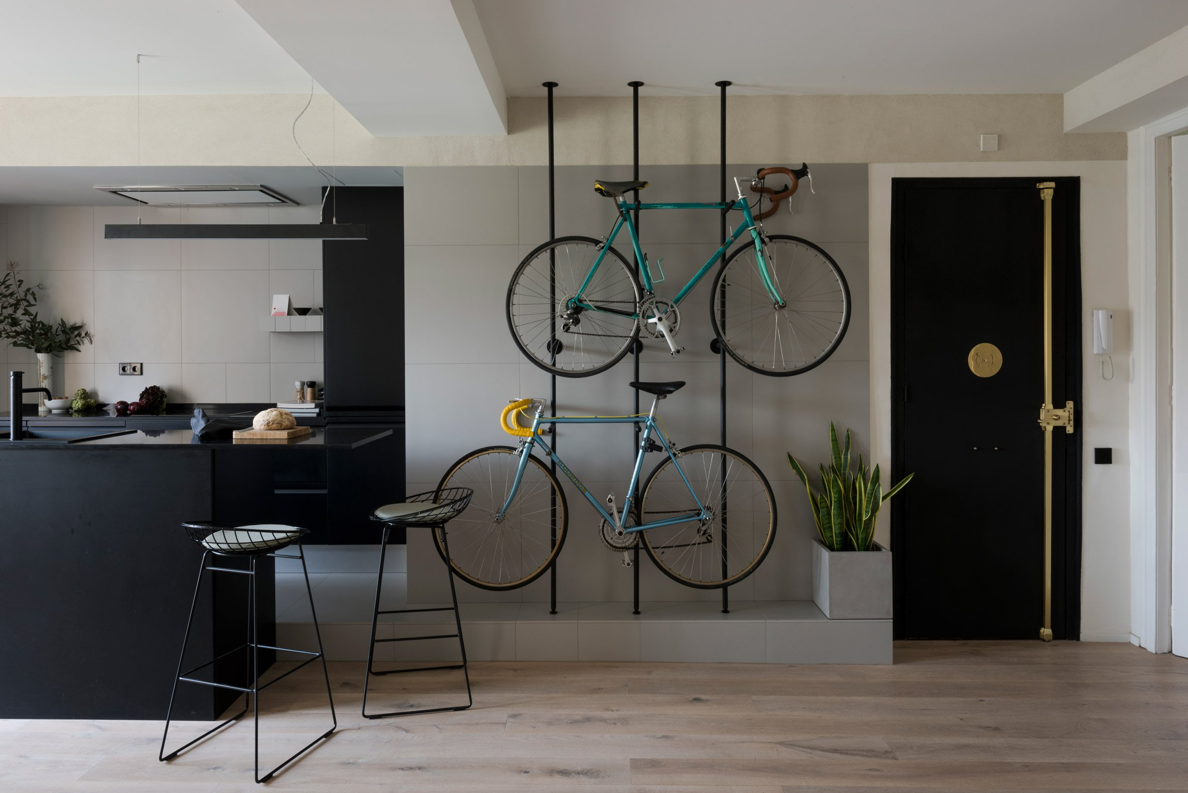 1. Home reno by Colombo and Serboli in Barcelona - Apartment renovation in Barcelona features bespoke bicycles storage