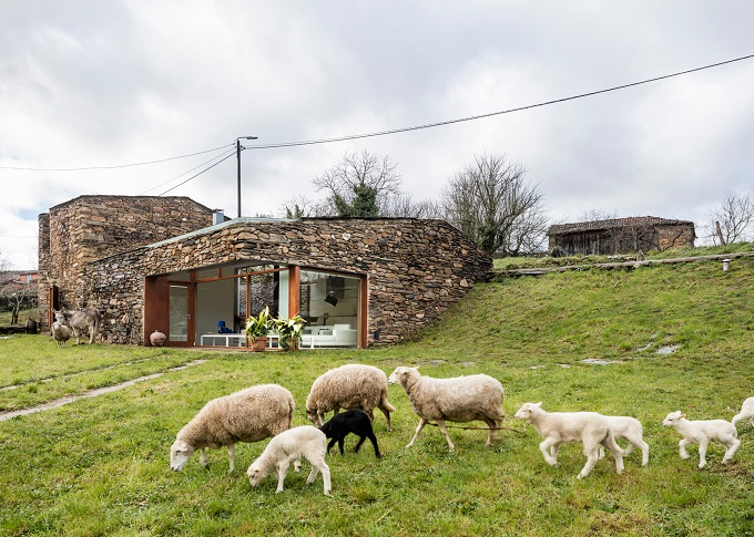 1. Stone wine cellar converted into home in Galicia - Stone wine cellar converted into a home by Cubus Arquitectura