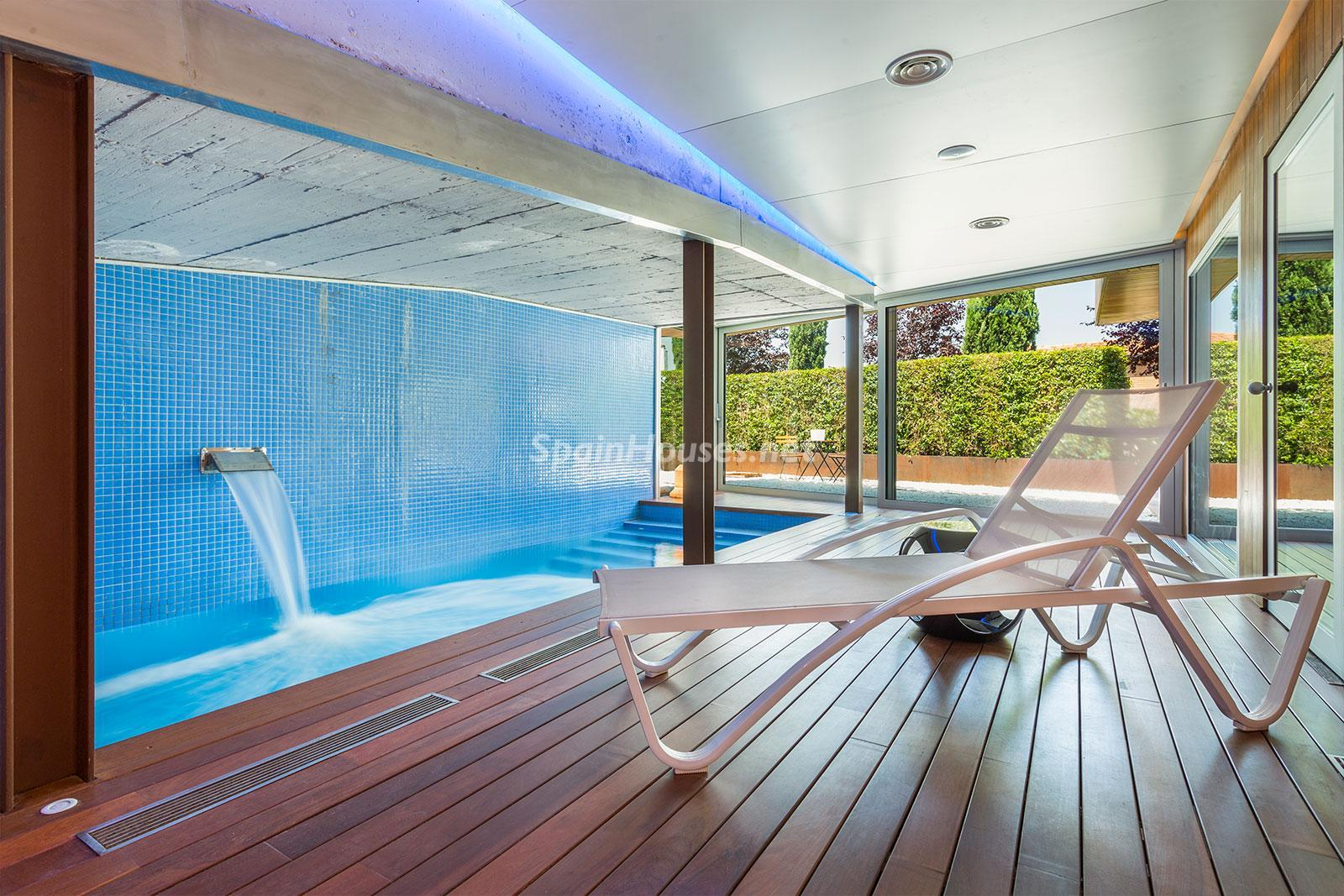 12. House for sale in Barcelona city - Superb 5 bed home in Barcelona features 2 swimming pools and a huge garden