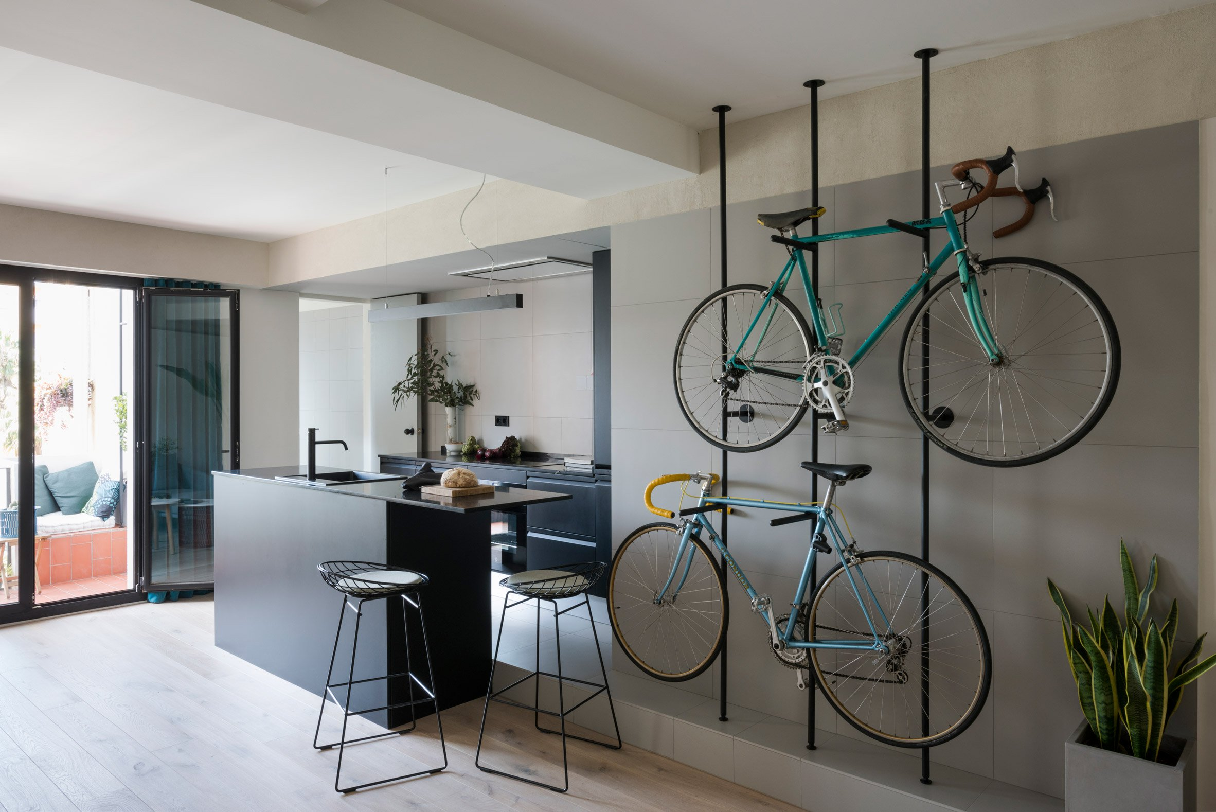 2. Home reno by Colombo and Serboli in Barcelona - Apartment renovation in Barcelona features bespoke bicycles storage