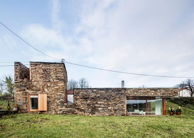 2. Stone wine cellar converted into home in Galicia - Stone wine cellar converted into a home by Cubus Arquitectura
