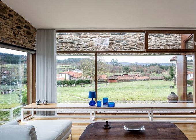 4. Stone wine cellar converted into home in Galicia - Stone wine cellar converted into a home by Cubus Arquitectura