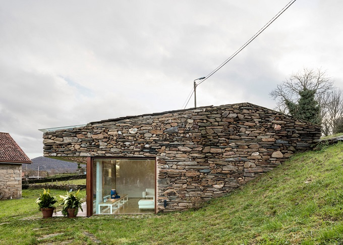 9. Stone wine cellar converted into home in Galicia - Stone wine cellar converted into a home by Cubus Arquitectura