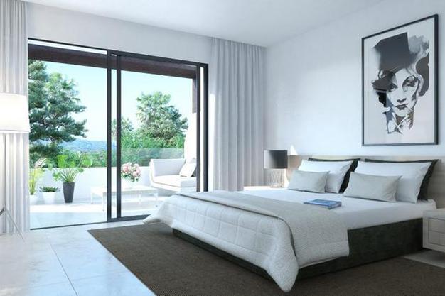 DORMITORIO PAREADOS - Luxury features and a private garden in these incredible duplexes in Málaga