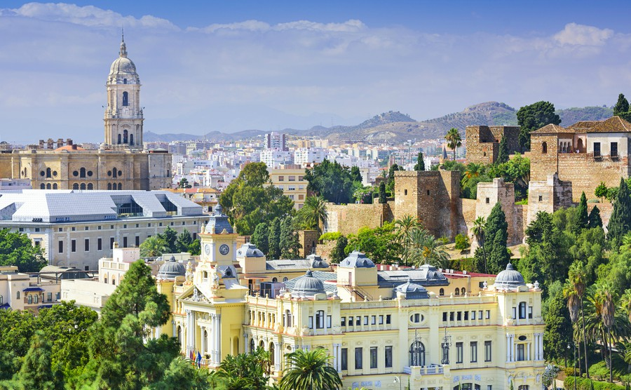 Malaga Spain cityscape at the Cathedral City Hall and Alcazaba citadel of Malaga. - Where to invest in Spain's booming property market in 2018