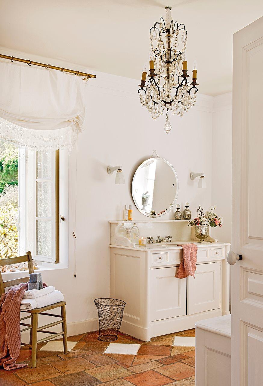 bano con lampara de arana y suelo de toba 874x1280 - La Ferme du Bon Dieu: A farm converted into a house which holds a love story