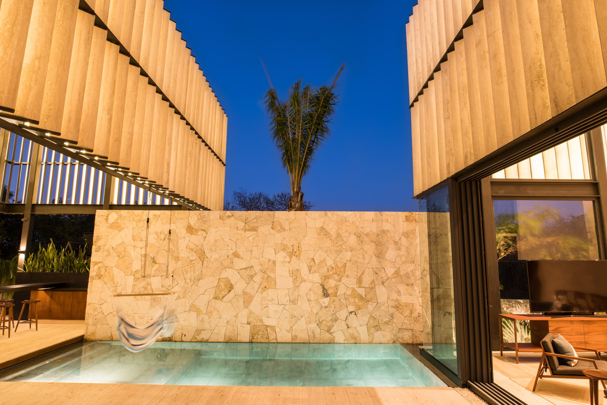 casa chaaltun tescala architects architecture residential houses mexico dezeen 2364 col 8 - Wonderful modern house with slatted marble walls in Mexico