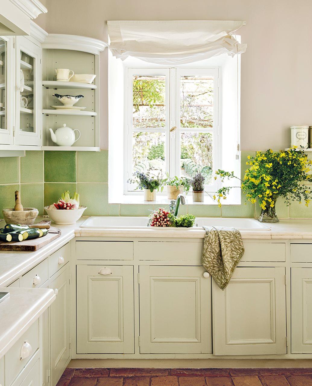 cocina con azulejos verdes y muebles en blanco 1035x1280 - La Ferme du Bon Dieu: A farm converted into a house which holds a love story