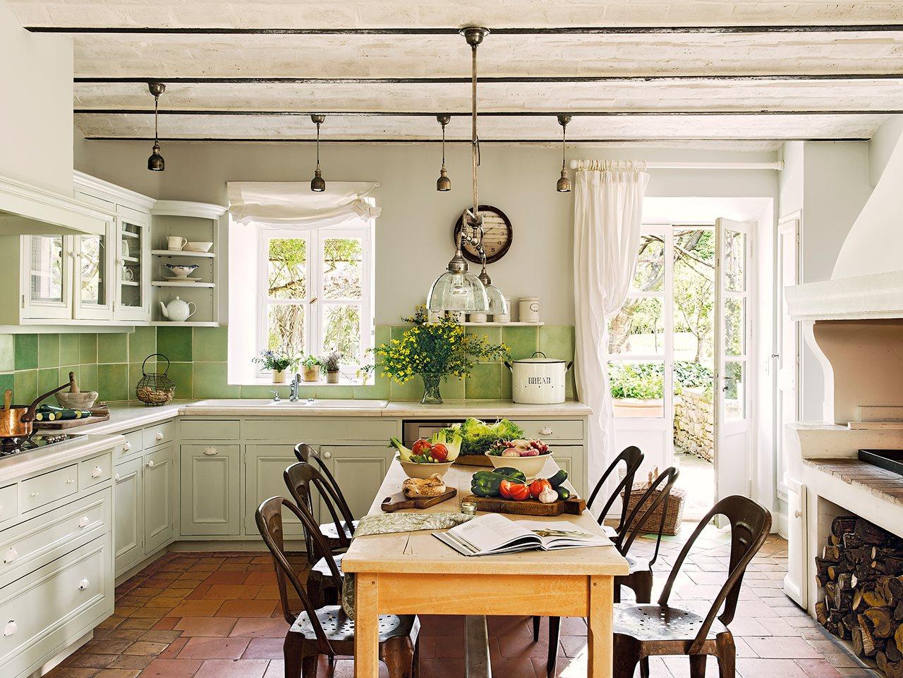 cocina con cocina de lena y azulejos verdes 1280x962 - La Ferme du Bon Dieu: A farm converted into a house which holds a love story