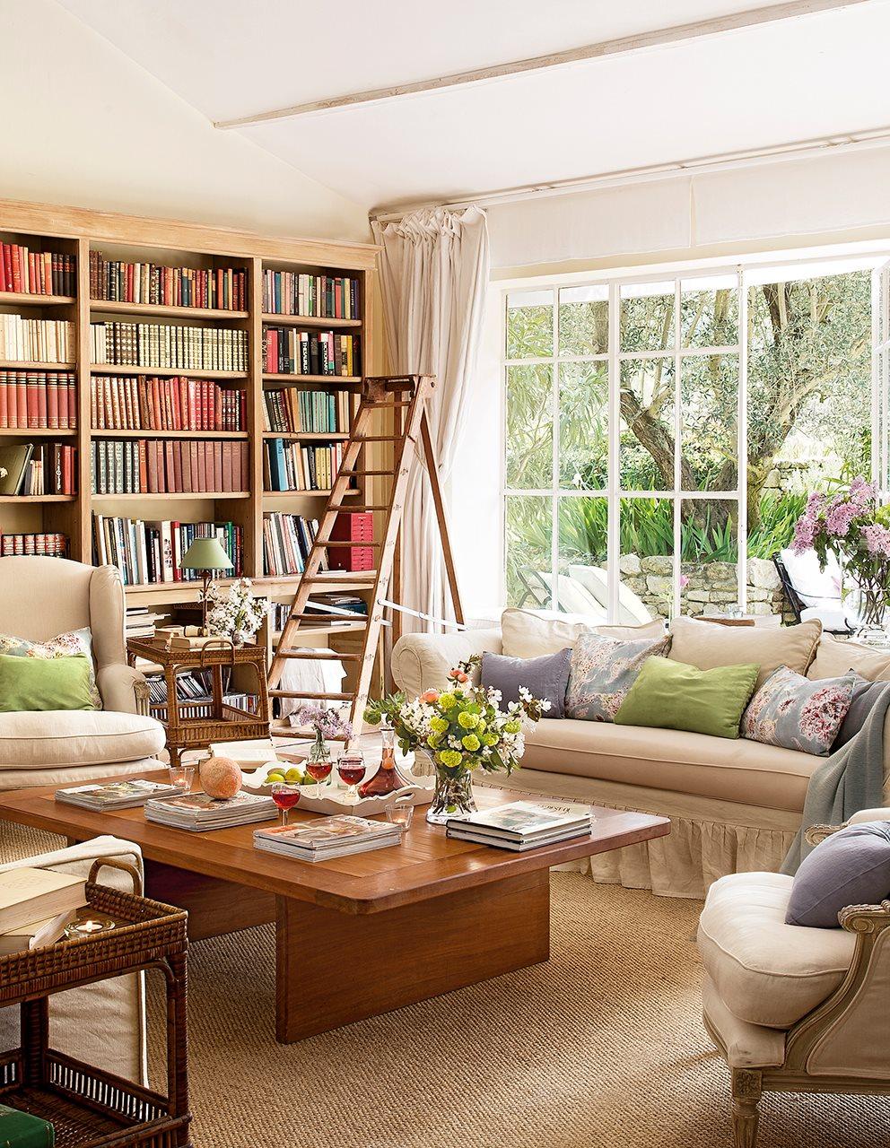salon biblioteca con libreria a medida y escalera 992x1280 - La Ferme du Bon Dieu: A farm converted into a house which holds a love story